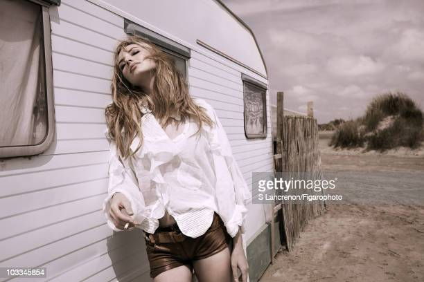 French actress Louise Bourgoin plays Calamity Jane at a photo session for Madame Figaro Magazine in 2010. Blouse by Tsumori Chisato, leather shorts...