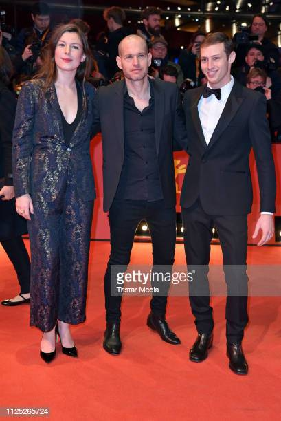 French actress Louise Chevillotte israelian director Nadav Lapid and isarelian Tom Mercier arrive for the closing ceremony of the 69th Berlinale...