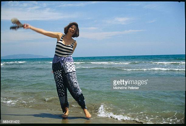 French actress Macha Meril goes for a paddle on the Italian coast.
