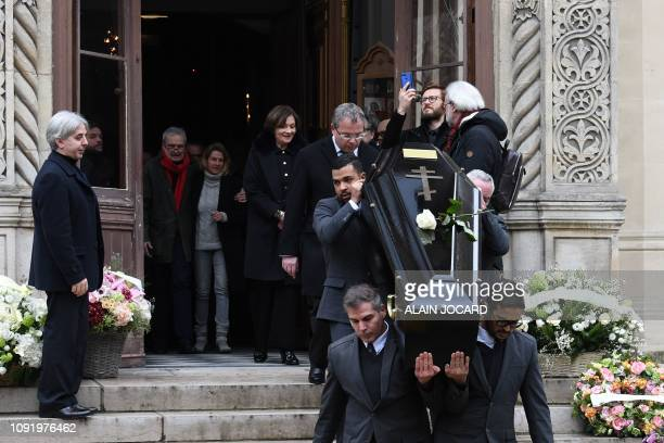 French actress Macha Meril leaves the Saint Alexandre Nevski Cathedral in Paris behind pallbearers carrying the coffin of her late husband French...