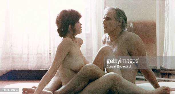 French actress Maria Schneider and American actor Marlon Brando on the set of Ultimo tango a Parigi written and directed by Italian Bernardo...