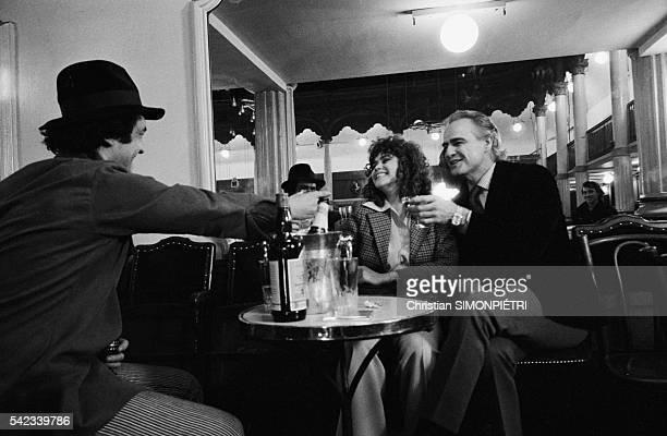 French actress Maria Schneider and American actor Marlon Brando with Italian director and screenwriter Bernardo Bertolucci on the set of his movie...