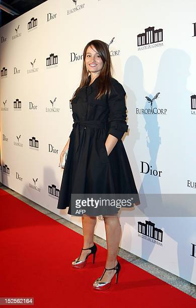French actress Marie Gillain poses as she arrives to attend the inauguration ceremony of the Cite du cinema a film studios complex heralded as...