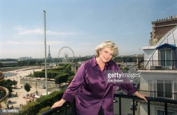 French actress MarieChristine Barrault poses on an apartment balcony overlooking the Place de la Concorde and the Ferris wheel in Paris