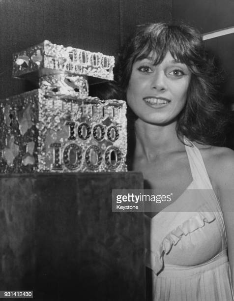 French actress MarieHélène Breillat with a jewelled perfume bottle created by Chaumet for Jean Patou's scent '1000' Paris France 17th October 1974...