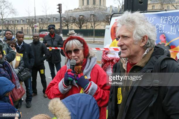 French actress Marina Vlady and President of the French Right to Housing association JeanBaptiste Eyraud take part in a gathering on December 25 in...