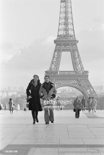 French actress Marina Vlady in front of the Eiffel Tower at the Trocadero Paris with her husband Vladimir Vysotsky a Russian antiestablishment actor...