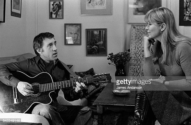 French actress Marina Vlady is serenaded by her husband Vladimir Vysotsky a Russian antiestablishment actor poet songwriter and singer in the Soviet...