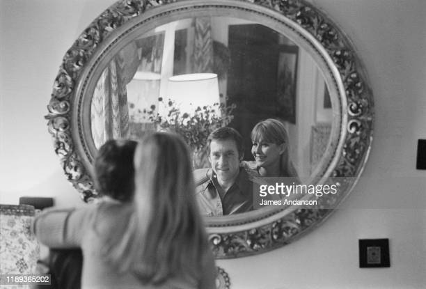 French actress Marina Vlady looking into a mirror at the home she shares with her husband Vladimir Vysotsky a Russian antiestablishment actor poet...
