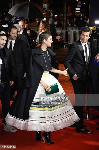 French actress Marion Cotillard and her partner French actor Guillaume Canet arrive for the 40th edition of the Cesar Awards ceremony on February 20...