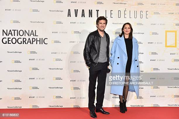 French actress Marion Cotillard and her partner French director and actor Guillaume Canet pose as they arrive for the Paris premiere of the...