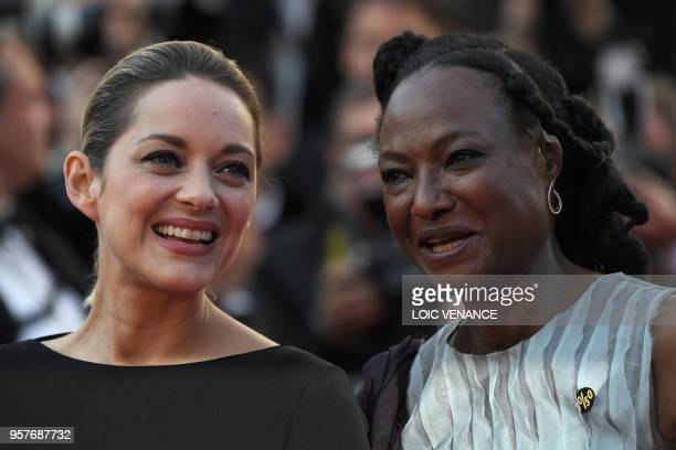 French actress Marion Cotillard and Niger director Rahmatou Keita walk the red carpet in protest of the lack of female filmmakers honored throughout...