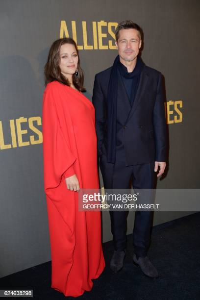 French actress Marion Cotillard and US actor Brad Pitt pose as they arrive for the premiere of the film 'Allied' on November 20 2016 in Paris / AFP /...