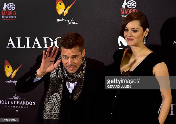 French actress Marion Cotillard and US actor Brad Pitt pose as they arrive for the premiere of the film 'Allied' on November 22 2016 in Madrid JULIEN