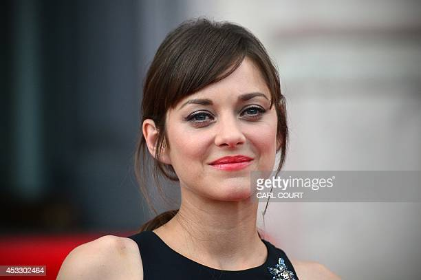 French actress Marion Cotillard attends the UK premiere of her film, Two Days, One Night in central London on August 7, 2014. AFP PHOTO / CARL COURT