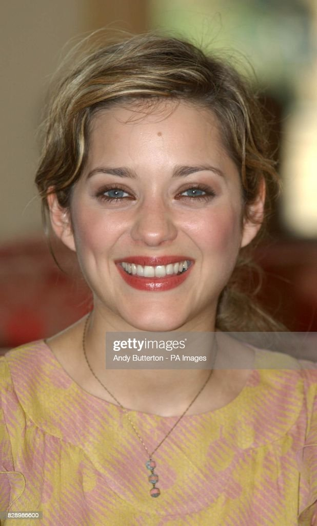 French actress Marion Cotillard during a photocall to launch the 2004 Renault French Film Season at the French Ambassador's Residence in Kensington, west London.