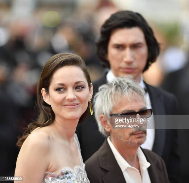 French actress Marion Cotillard , French film director Leos Carax and US actor Adam Driver arrive for the screening of the film âAnnette' in...