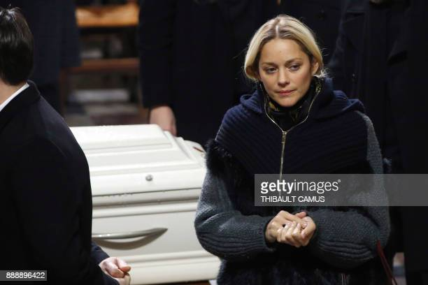 French actress Marion Cotillard pays her last respects during the funeral service of French musician Johnny Hallyday at La Madeleine Church in Paris...