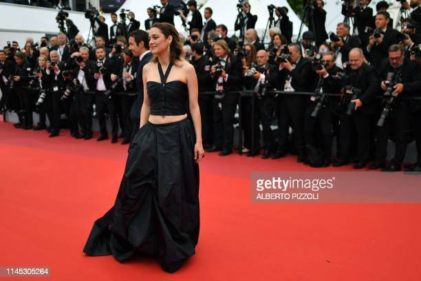 """French actress Marion Cotillard poses as she arrives for the screening of the film """"La Belle Epoque"""" at the 72nd edition of the Cannes Film Festival..."""