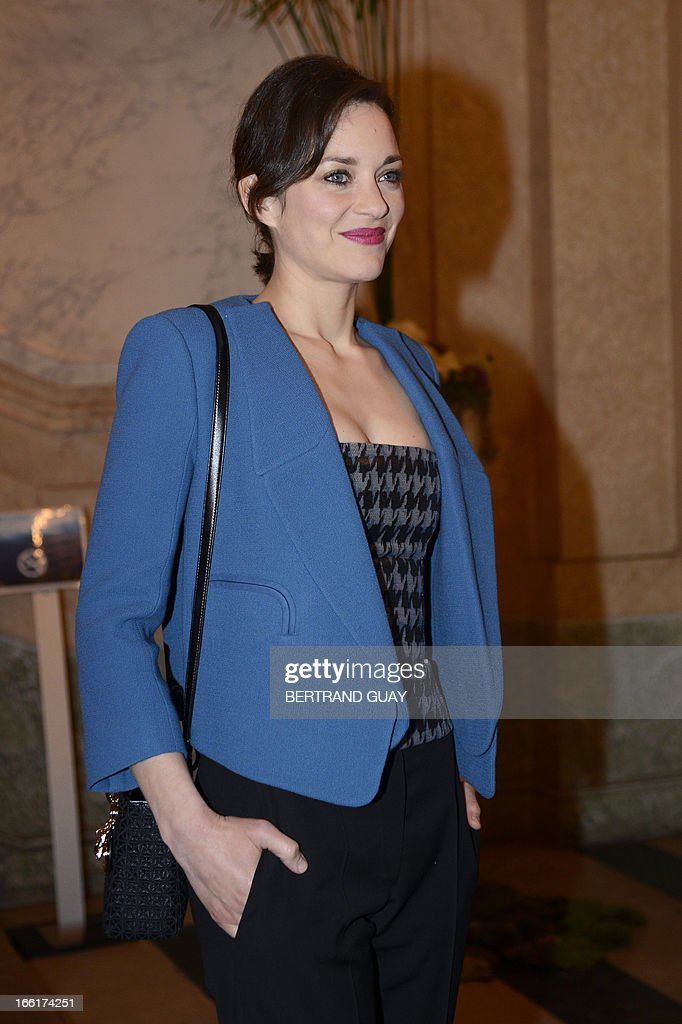French actress Marion Cotillard poses as she arrives on April 9, 2013, at the Hotel de la Marine in Paris, prior to the yearly charity gala organized by the Foundation of French skipper Maud Fontenoy (to preserve oceans).