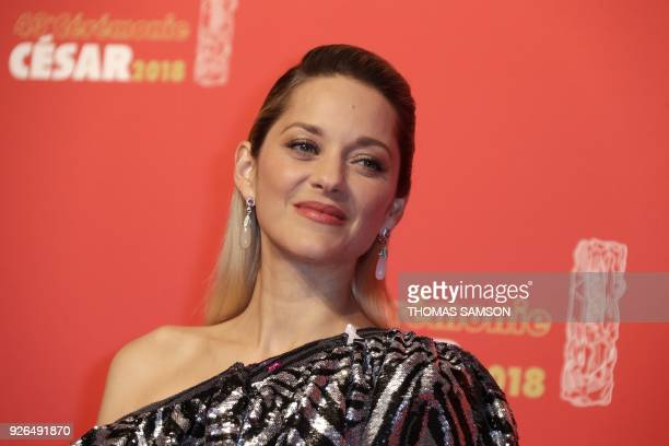 TOPSHOT French actress Marion Cotillard poses during a photocall at the 43rd edition of the Cesar Awards ceremony at the Salle Pleyel in Paris on...