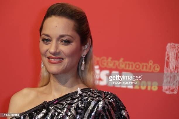 French actress Marion Cotillard poses during a photocall at the 43rd edition of the Cesar Awards ceremony at the Salle Pleyel in Paris on March 2...