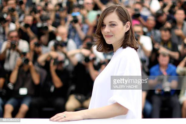 TOPSHOT French actress Marion Cotillard poses on May 17 2017 during photocall for the film 'Ismael's Ghosts' ahead of the opening ceremony of the...