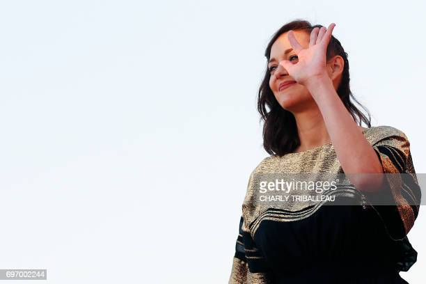 TOPSHOT French actress Marion Cotillard poses on the red carpet on June 17 2017 during the Cabourg Romantic Film Festival in Cabourg northwestern...