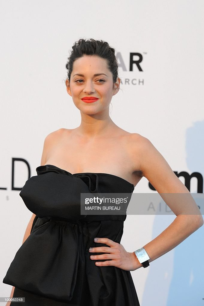 French actress Marion Cotillard poses while arriving to attend the 2010 amfAR's Cinema Against Aids on May 20, 2010 in Antibes, southeastern France.