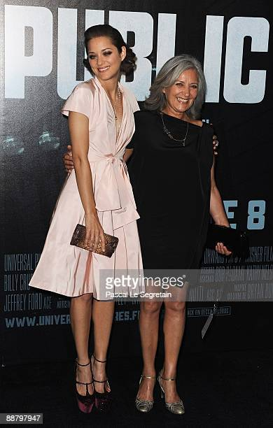 French Actress Marion Cotillard poses with her mother Niseema Theillaud as they attend the Public Enemies film premiere at Cinema Gaumont Marignan on...