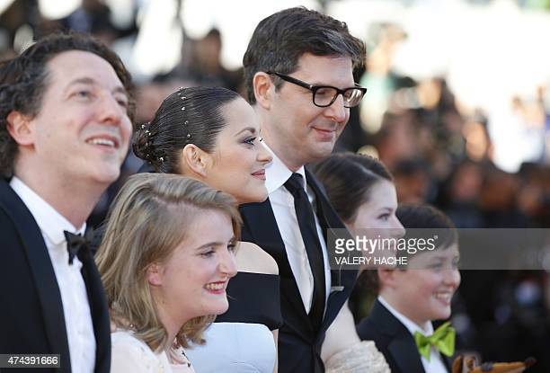 French actress Marion Cotillard poses with US director Mark Osborne as they arrive for the screening of the film The Little Prince at the 68th Cannes...