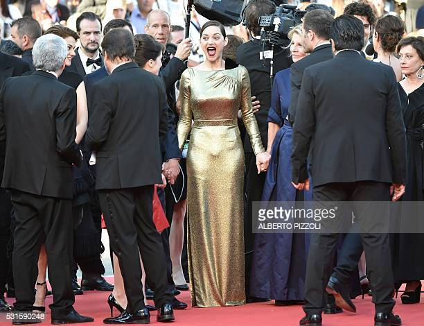 """French actress Marion Cotillard reacts as she arrives on May 15, 2016 for the screening of the film """"Mal de Pierres """" at the 69th Cannes Film..."""