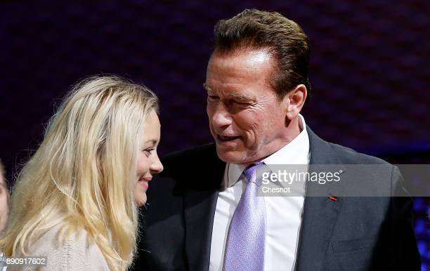 French actress Marion Cotillard speaks with R20 Founder and former California state governor Arnold Schwarzenegger at the end of a working session...