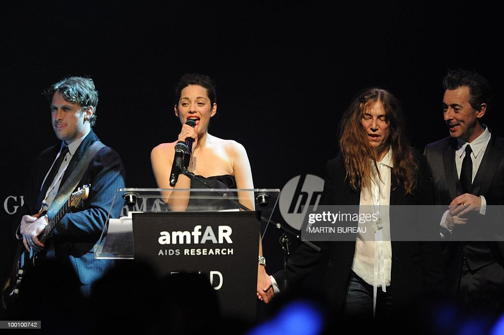 French actress Marion Cotillard (2dL), US singer Patti Smith and British actor Alan Cumming lead the auction at amfAR's Cinema Against Aids 2010 benefit gala on May 20, 2010 in Antibes, southeastern France.