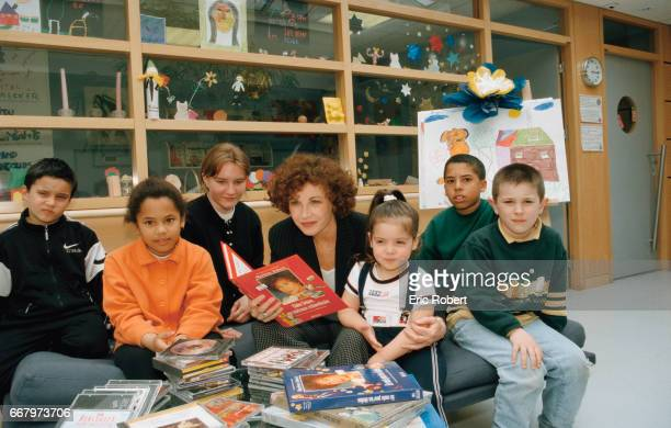 French actress Marlene Jobert reads to children at a hospital in support of the Bayer Sante Foundation Governed by the Foundation of France Bayer...