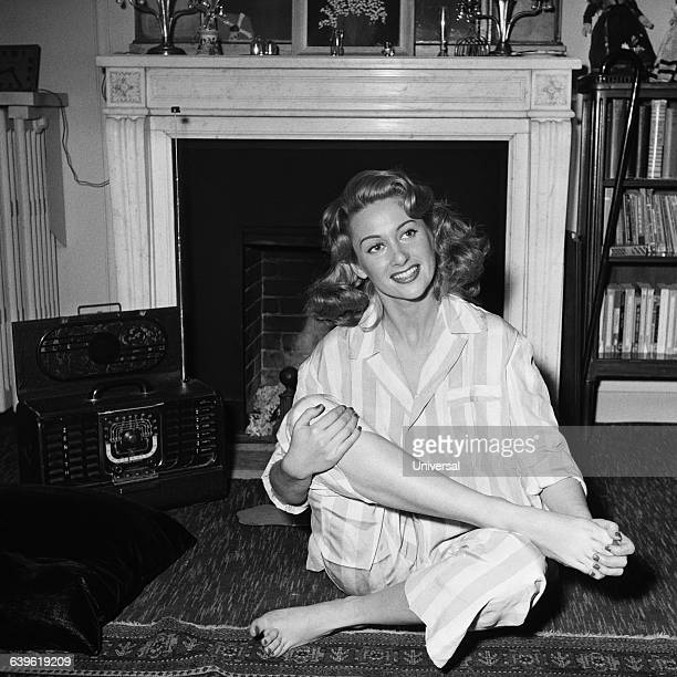 French actress Martine Carol at home in pajamas