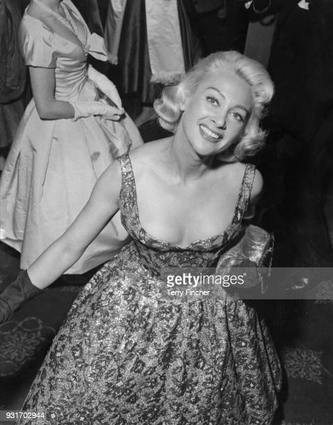 French actress Martine Carol attends a film premiere at the Gaumont Cinema Haymarket in London as part of the French Film Festival 24th March 1957