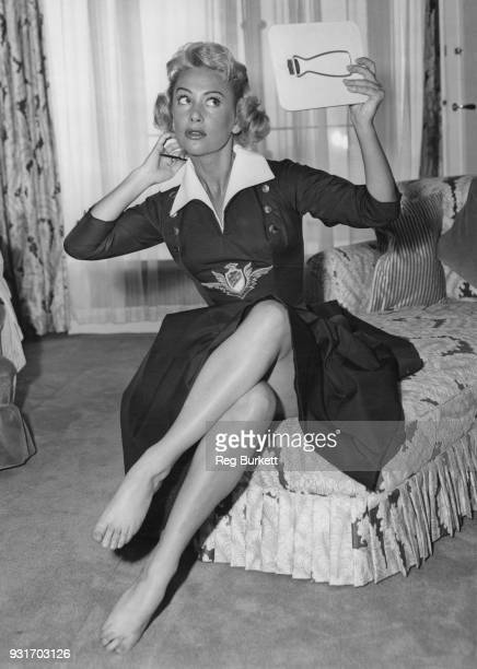 French actress Martine Carol checks her makeup at the Savoy Hotel in London 25th April 1956 She appearing in the BBC television show 'This is Show...