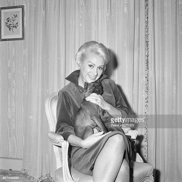 French Actress Martine Carol Holding Pug