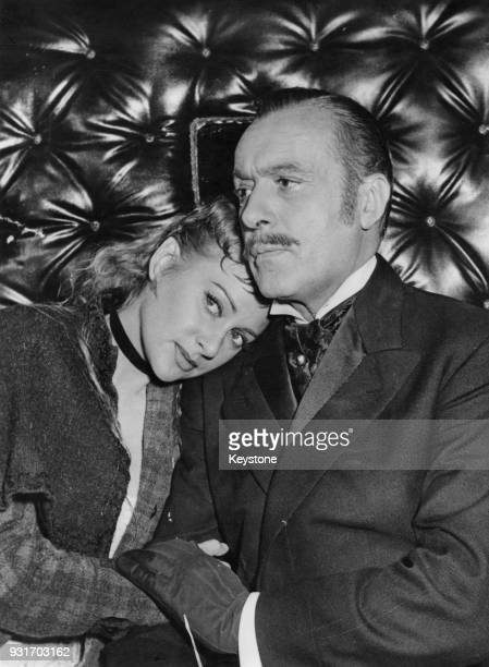 French actress Martine Carol stars with French actor Charles Boyer in the film 'Nana' adapted from the book by Émile Zola 15th September 1954 The...