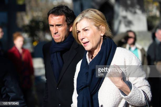 French actress Michele Laroque and Carrefour's CEO Alexandre Bompard arrive for the funeral ceremony for French journalist Philippe Gildas at the...