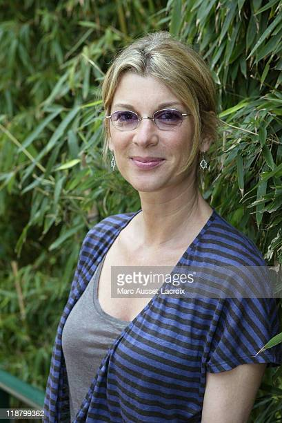 French actress Michele laroque poses at the 'Village' during the 8th day of French Open Tennis tournament held at Roland Garros stadium in Paris...