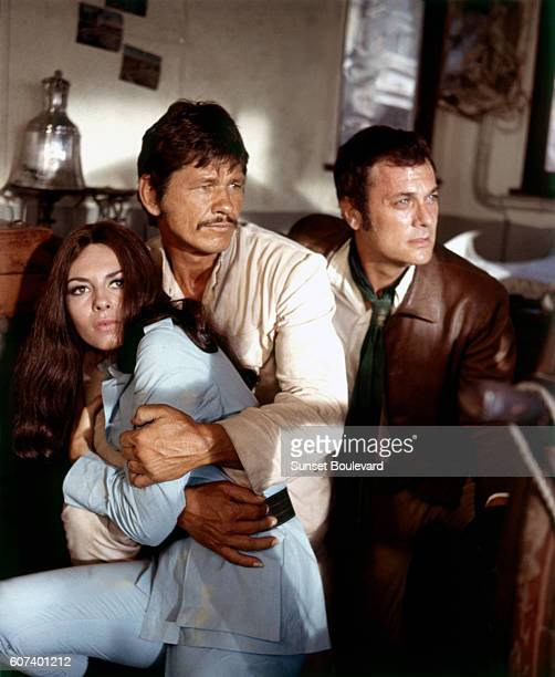 French actress Michele Mercier with American actors Charles Bronson and Tony Curtis on the set of You Can't Win 'Em All directed by British Peter...