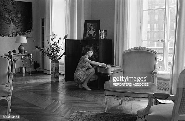 French Actress Michèle Mercier at Home in Paris, France, on April 16, 1964 .