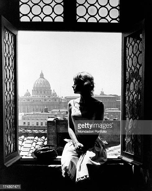French actress Mijanou Bardot sitting on windowsill facing St Peter's Basilica She is the sister of French actress Brigitte Bardot Rome 5th August...