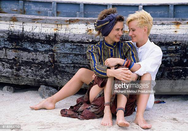 French actress Miou-Miou and her sister Marie-Claude share an embrace on the beach in Mauritius, France.