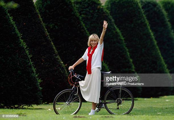 French Actress Mireille Darc on Bicycle