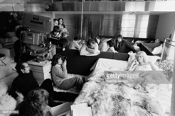 """French actress Mireille Darc on the set of the film """"Le Telephone Rose"""" , directed by the French director Edouard Molinaro, seated on the stairs to..."""
