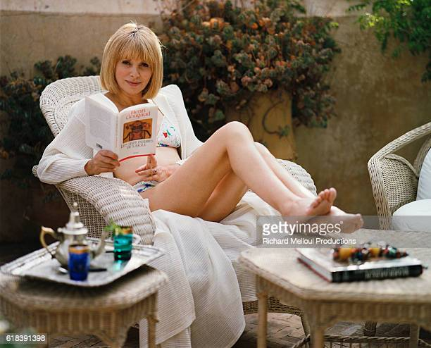 French actress Mireille Darc reading a book in Marrakech