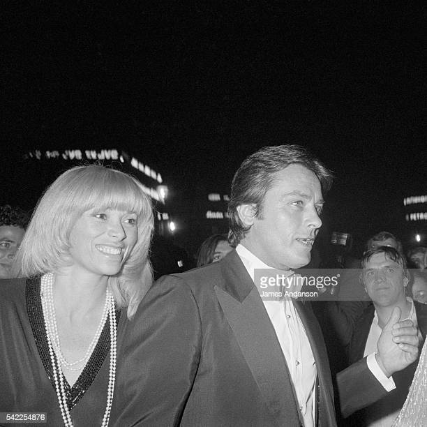 French actress Mireille Darc with her longterm partner actor Alain Delon arriving at a tribute gala for Italian director Luchino Visconti at the...